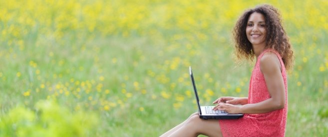 Girl with Laptop in Field (675 x 275)