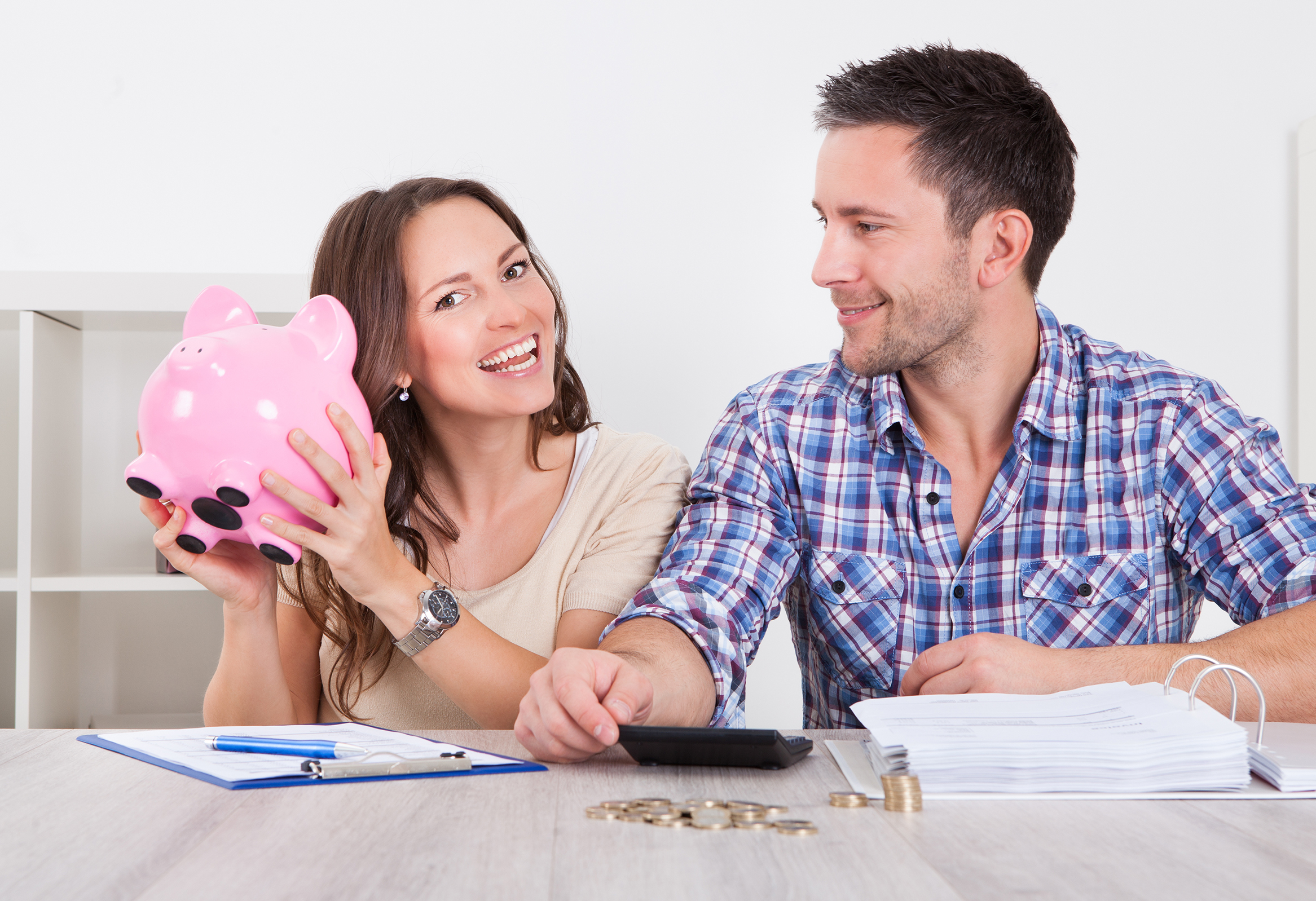 man and woman with piggy bank