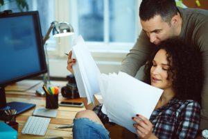Couple paying bills at computer