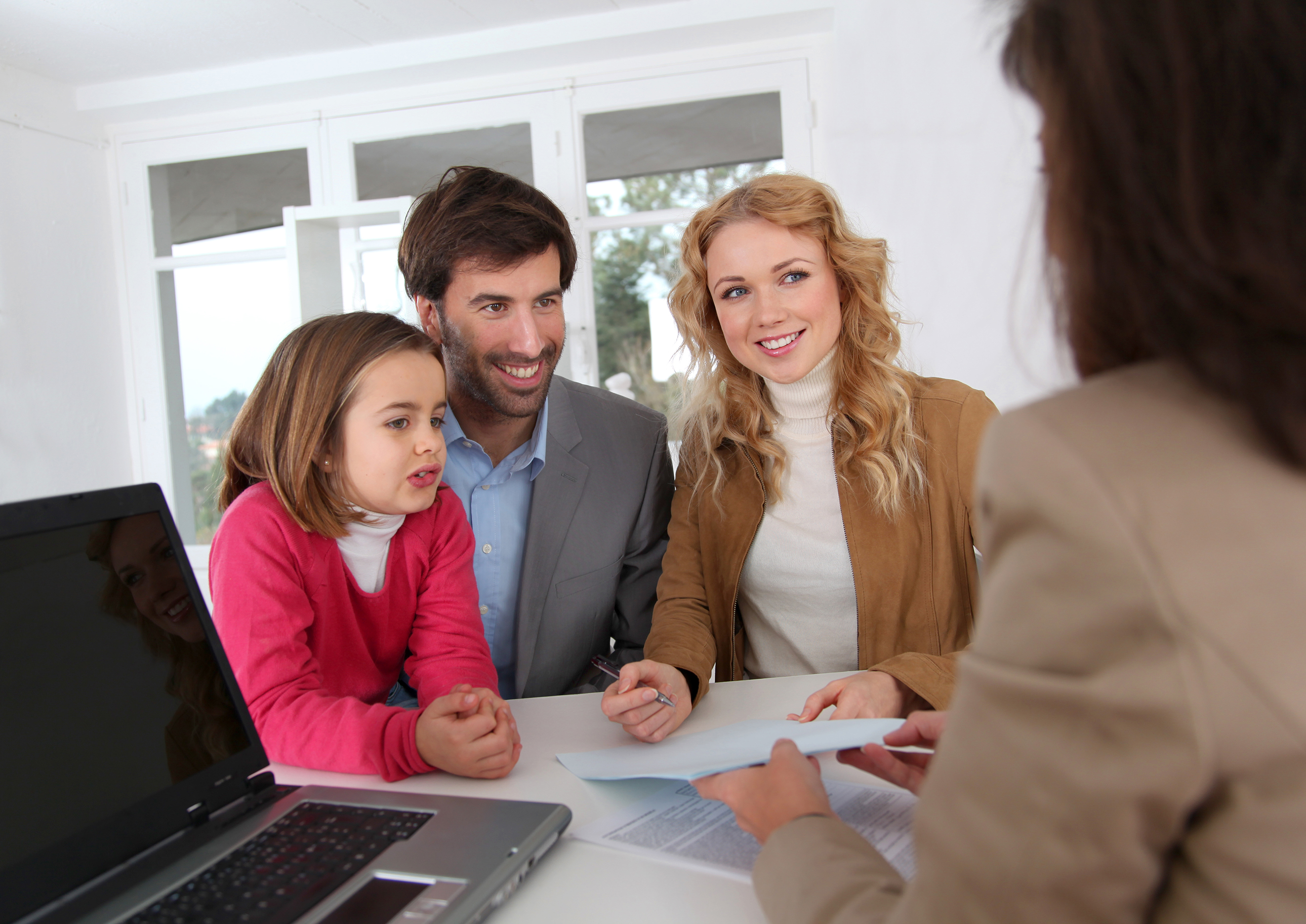 Family teaching child about money