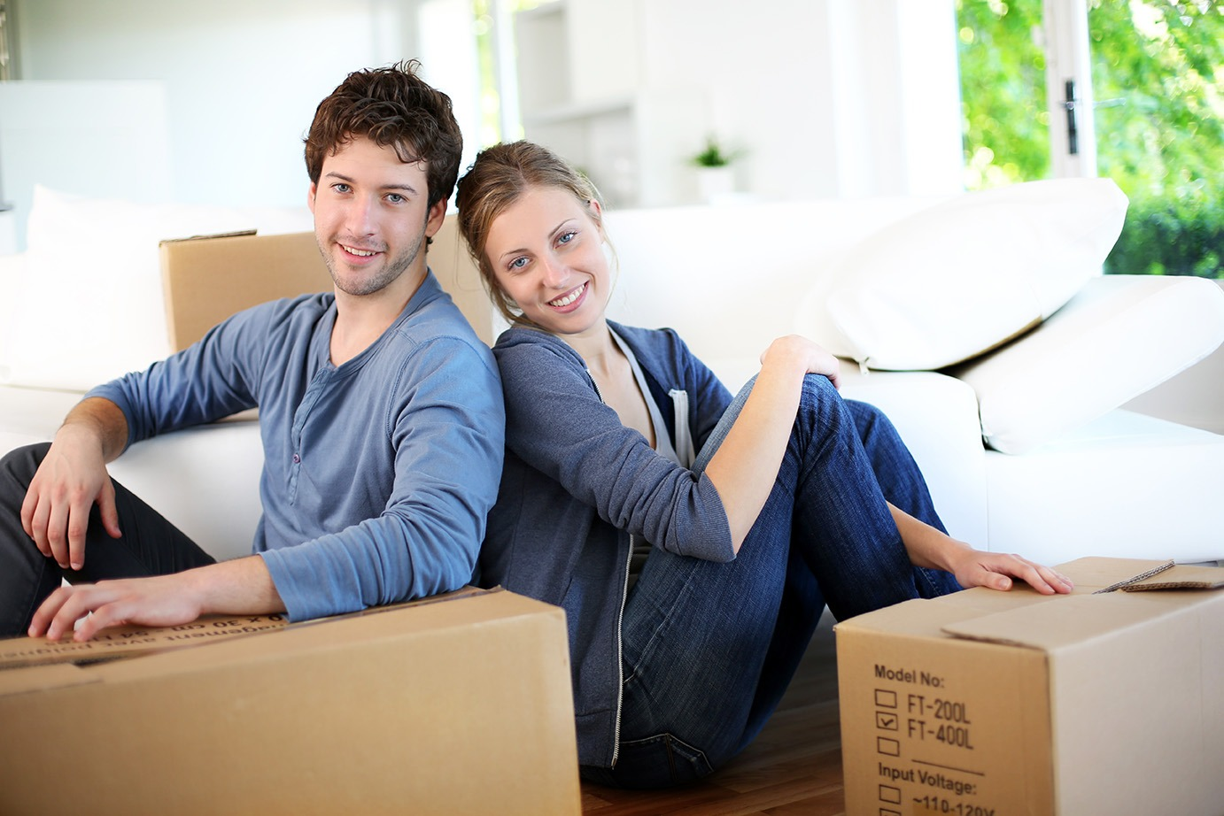 man and woman with moving boxes